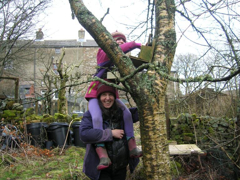 17.1 Kim and Elsa fill squirrel feeder